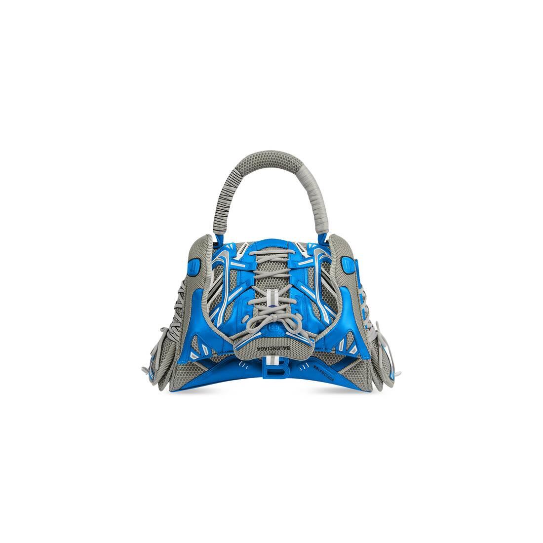 Display zoomed version of sneakerhead medium top handle bag 1