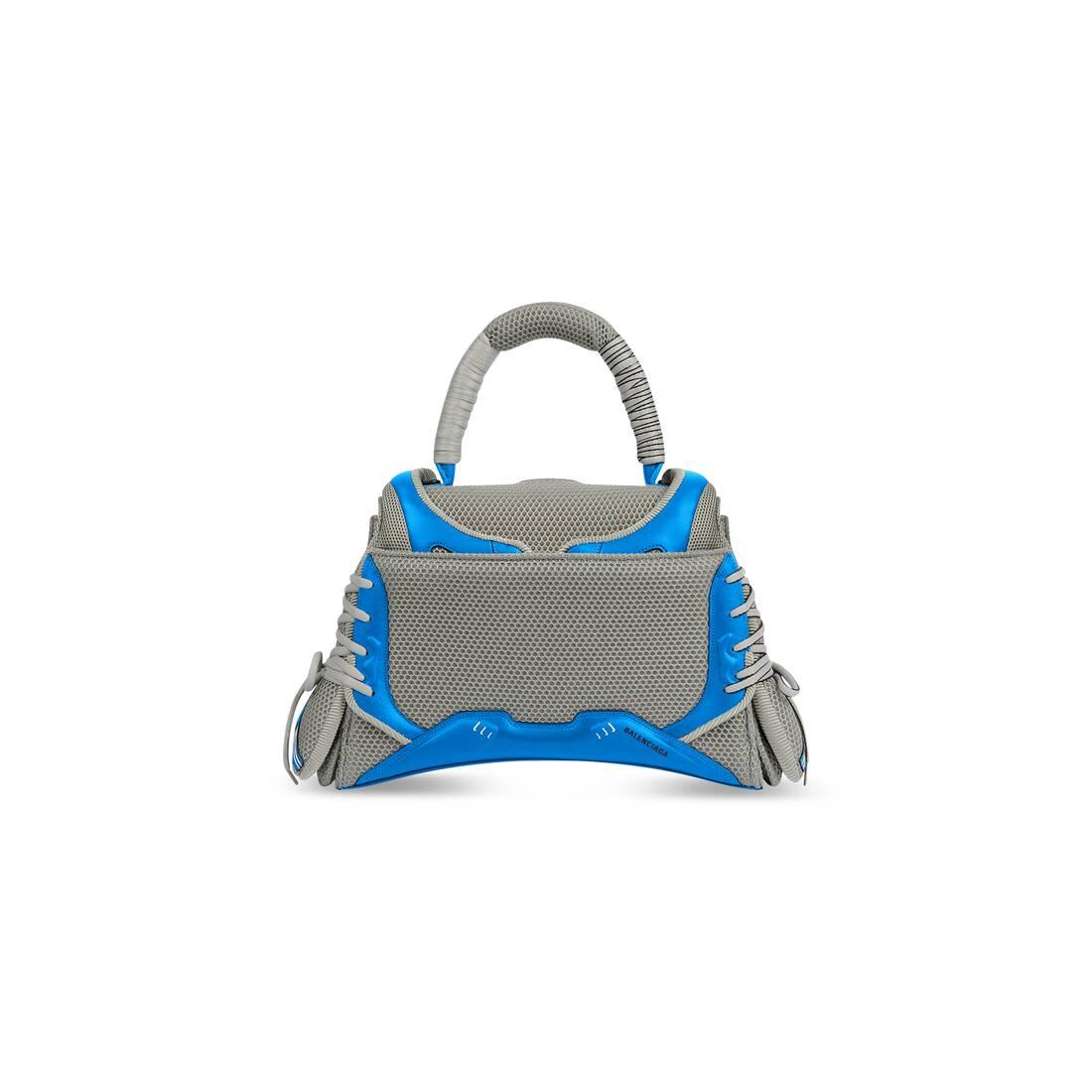 Display zoomed version of sneakerhead medium top handle bag 2