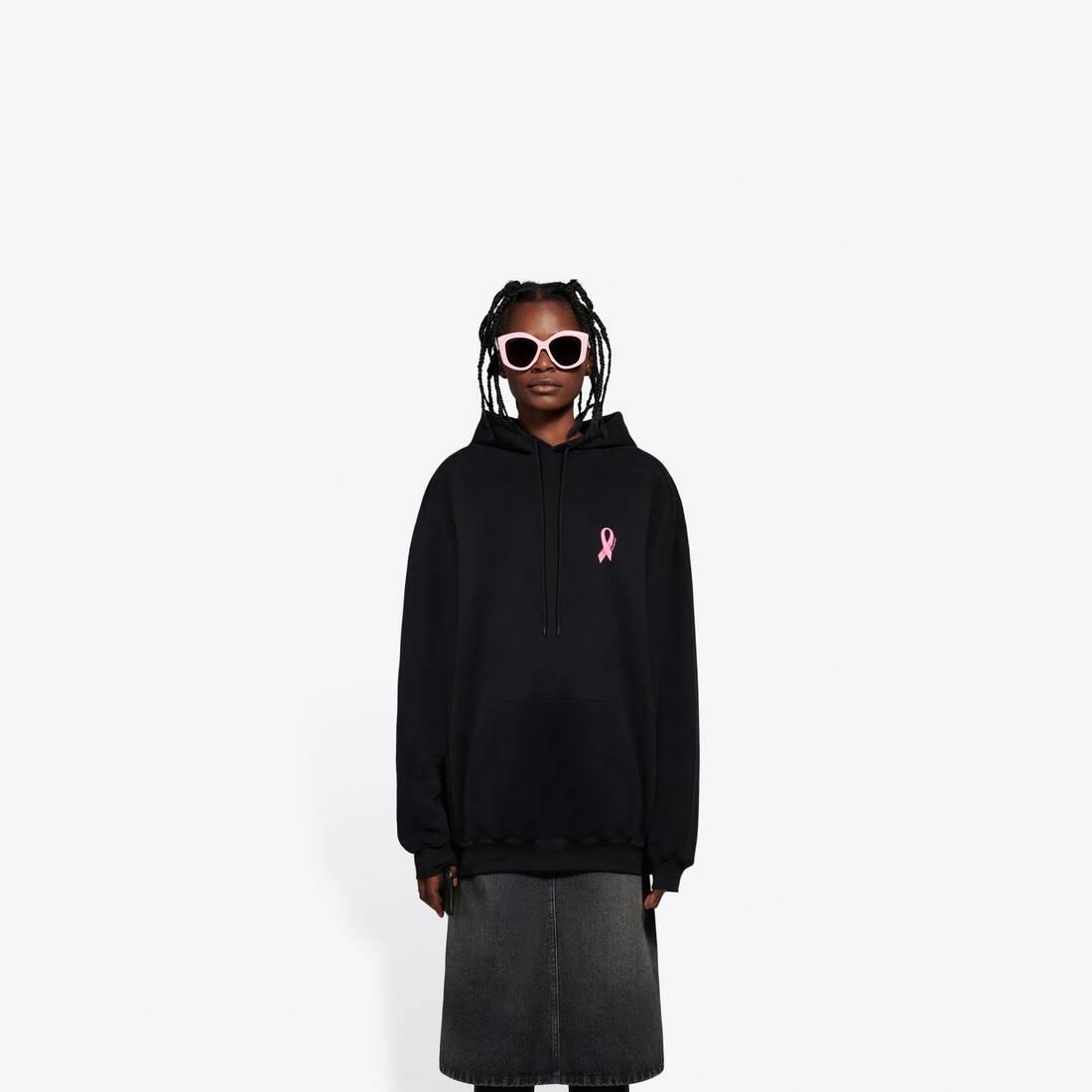 Display zoomed version of we are pink medium fit hoodie 3